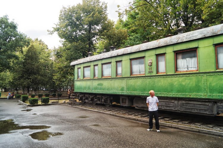 Man in front of the Stalins private carriage in Stalin Museum, Gori