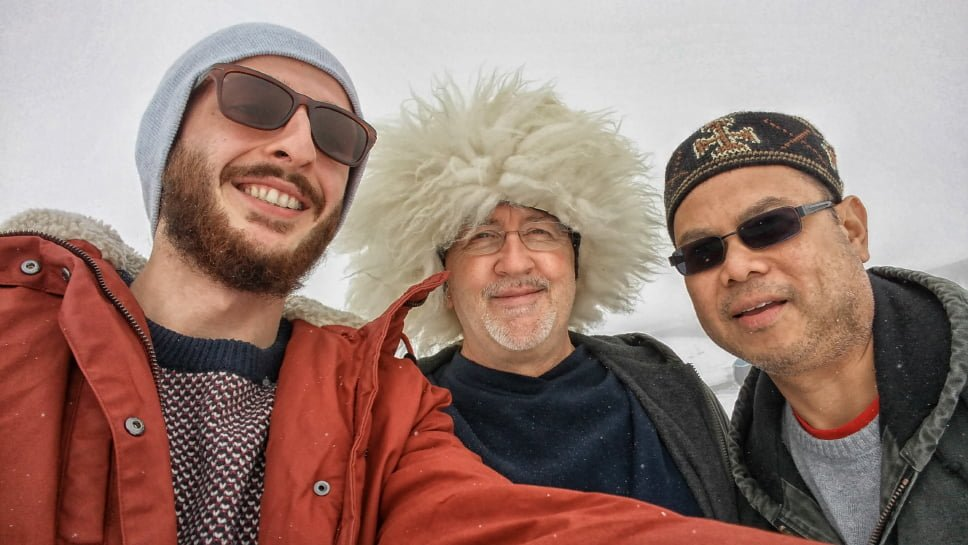Guide and tourists during the Kazbegi tour, funny hats