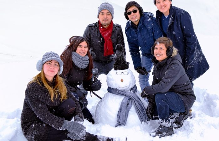 Gudauri Tour Winter Wonderland Group of toursists with a snowman