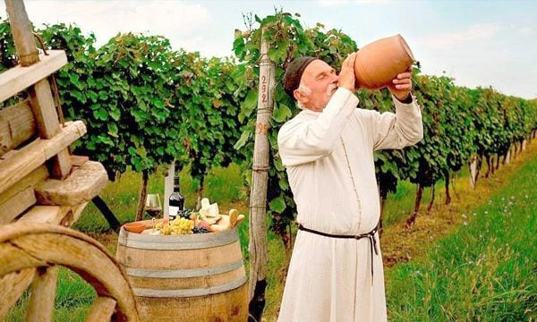 Best Georgia Tours Old Man Drinking Georgian Wine in Vineyard