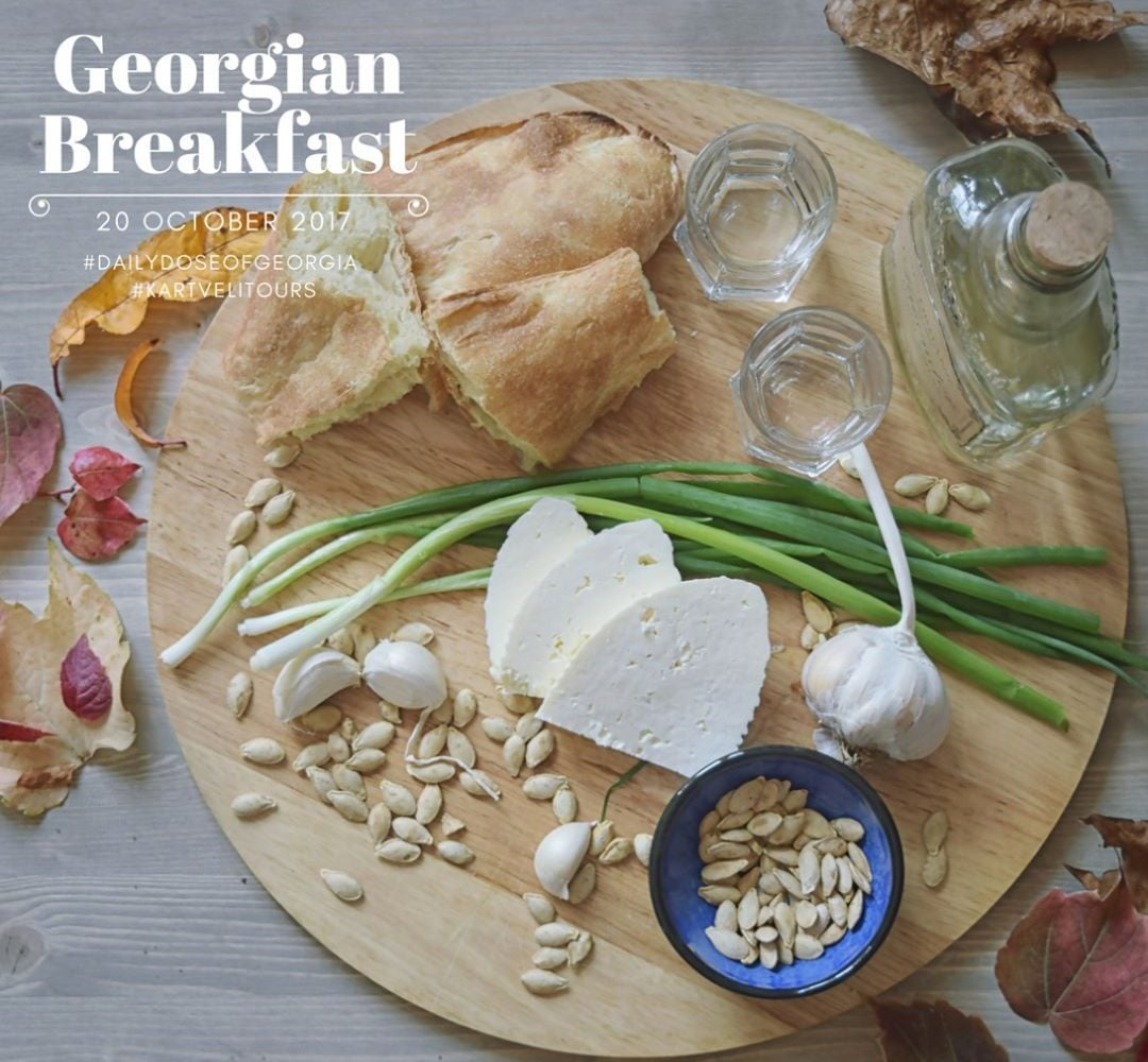 Georgian farmers breakfast, bread cheese and chacha