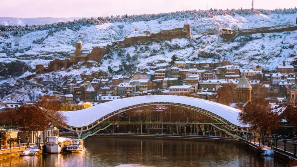 tbilisi in winter, peace bridge covered with snow
