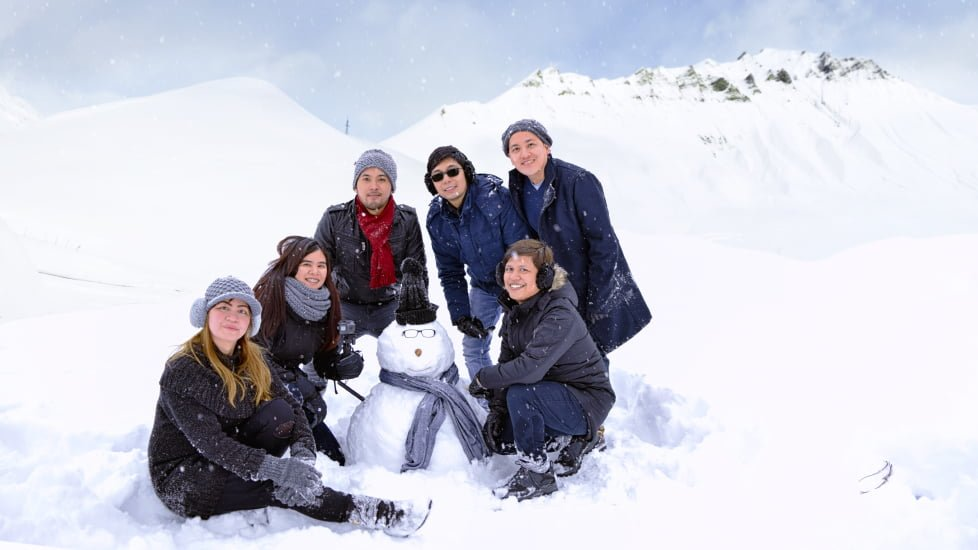 group of tourists with snowman in gudauri georgia