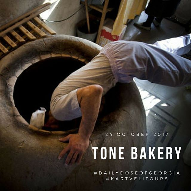 Tone Bakery, baker diving into the oven to bake bread