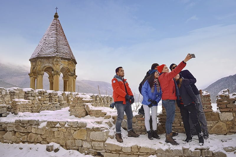 group of toursists taking selfie at Ananuri Fortress