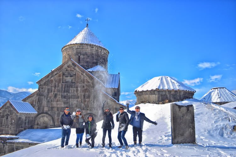 Having fun in Haghpat Monastery in snow winter in Armenai